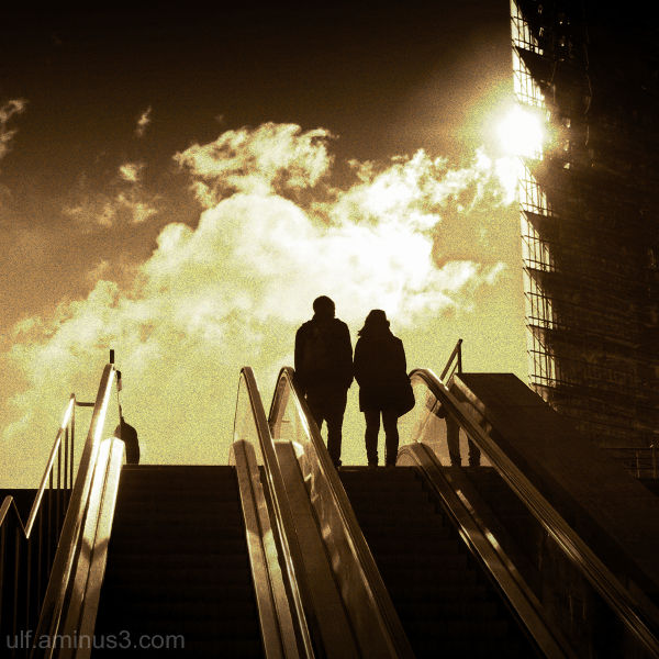 Couple going upstairs into the light