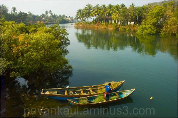 fisherman at work on riverbank