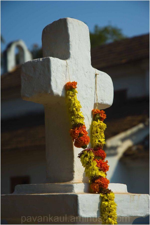 garlanded cross keeps vigil on church