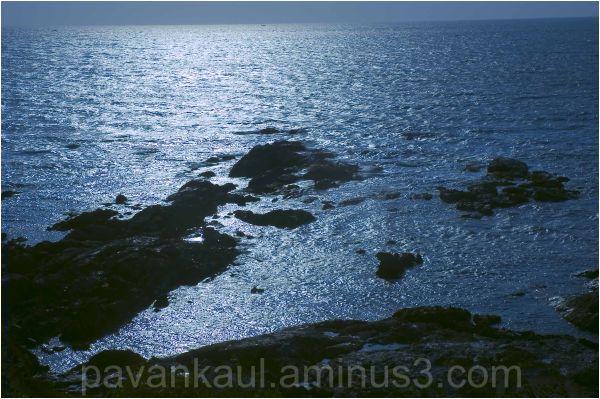 Sun glittering on Sea rocks