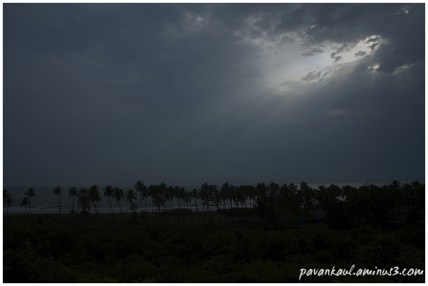sunrays through clouds on goan beach