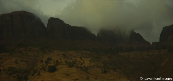 hills beneath stormy skies