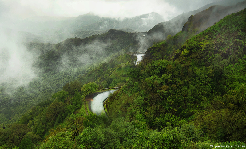 winding road on foggy hills
