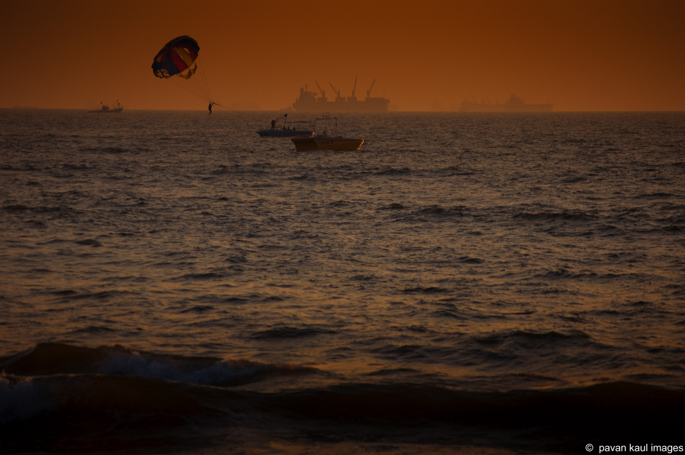 parasailing at sunset in goa