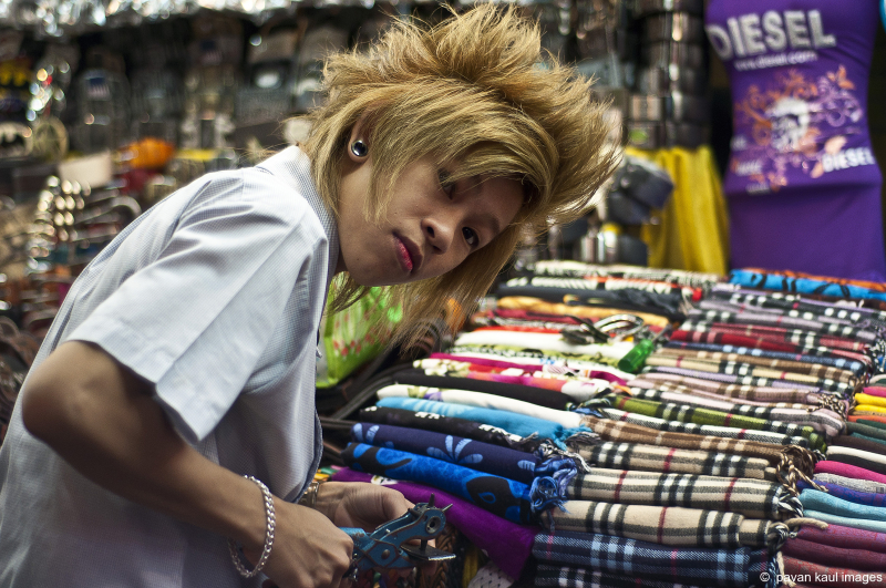 man with crazy hairdo in bangkok nightmarket