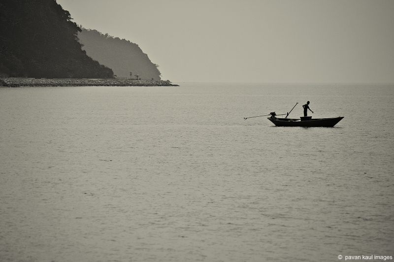 man fishing in ocean