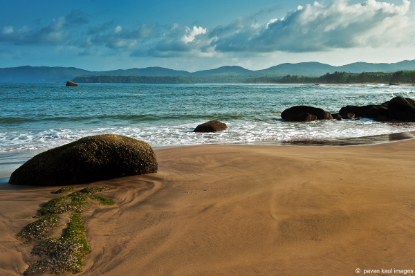 sand and sea on serene beach at agonda goa
