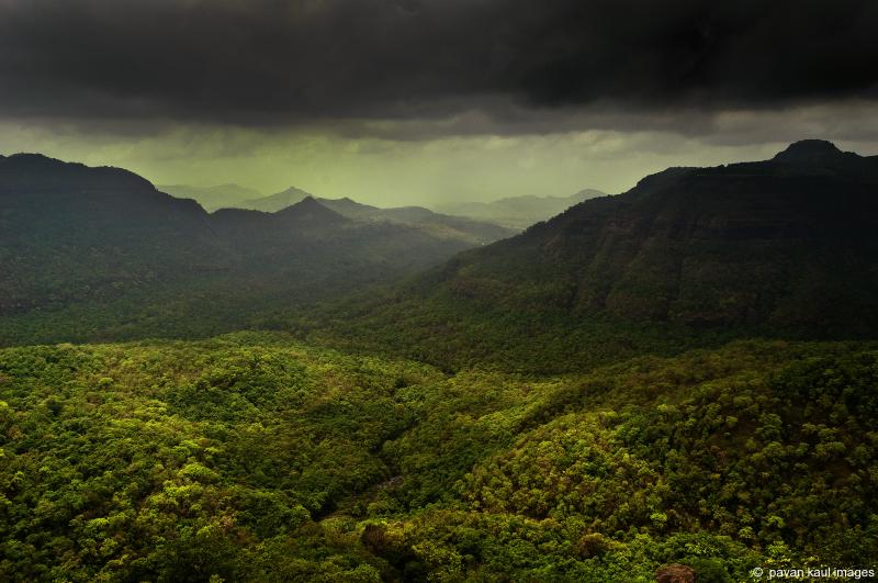 rainclouds over hills