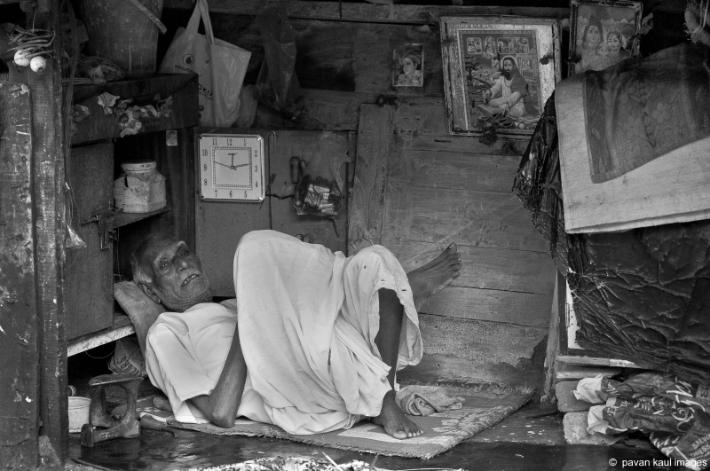 a poor cobbler in his shop