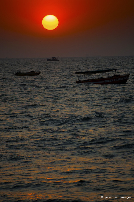 sunsets over anchored boats