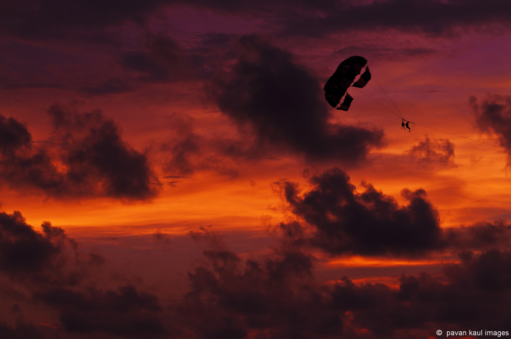 parasailing at sunset