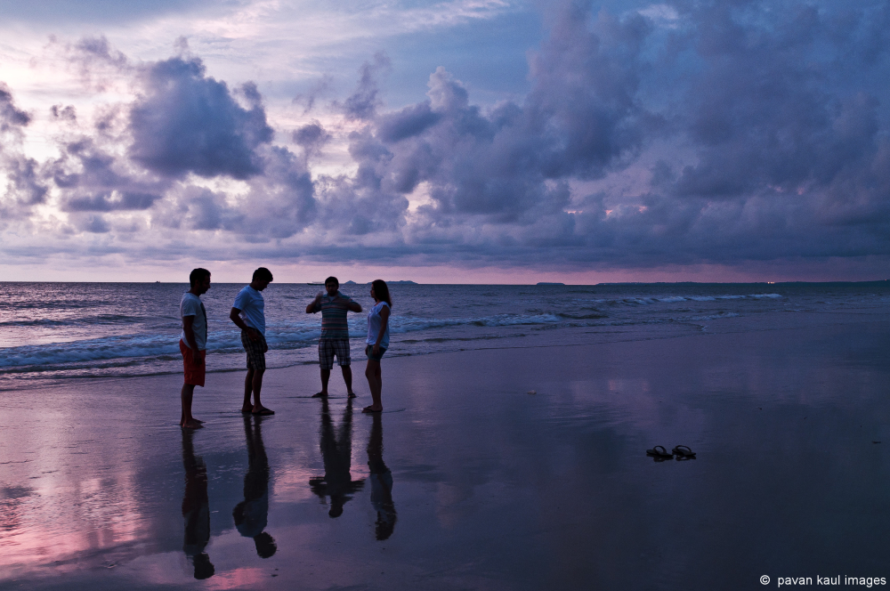 my kids on a goan beach at sunset