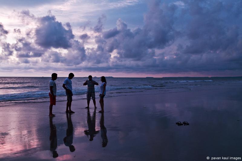 my kids on a goan beach at sunset