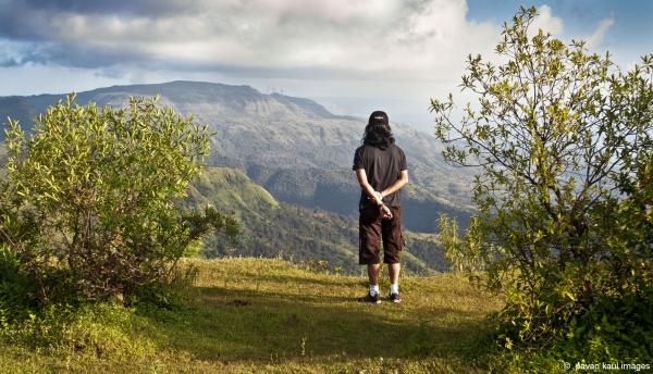 man reflecting amidst nature