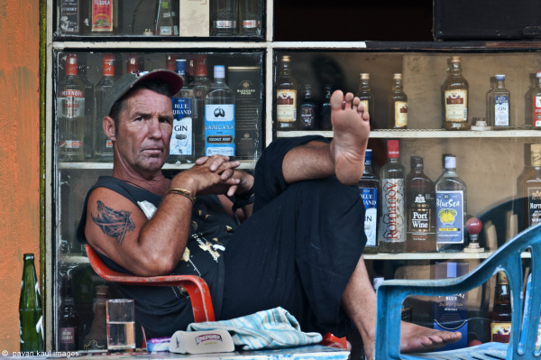 man in a bar on street in goa
