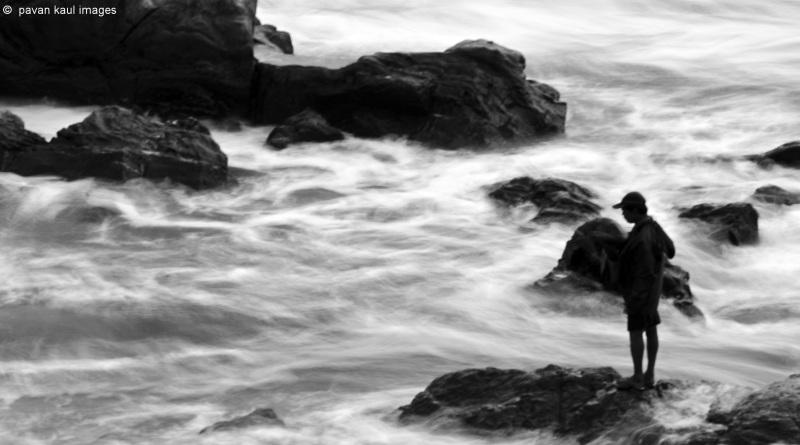 fisherman on rocks