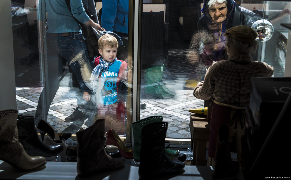 boy and old widow stare at shop window