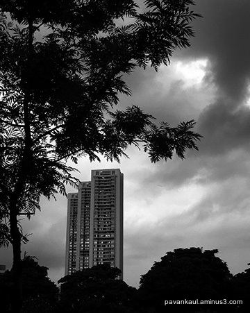 monochrome cityscape against monsoon skies
