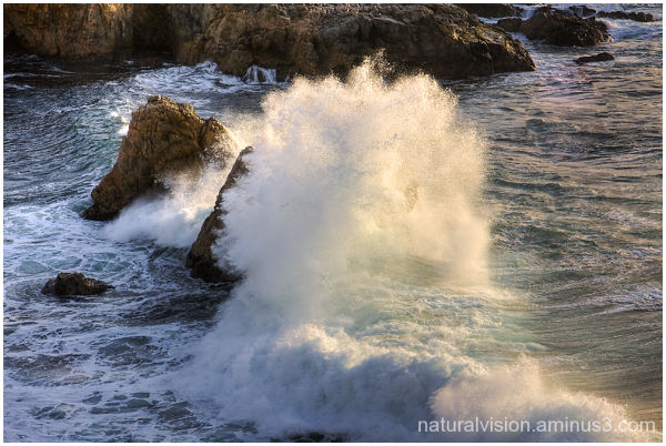 Wave crashing on two rocks