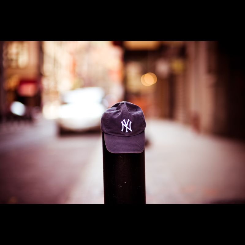 Yankees hat on a stall