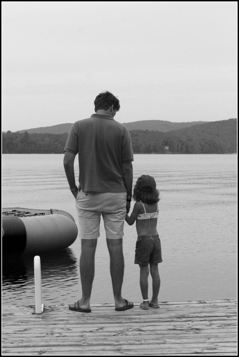 father and daughter at canadian lake