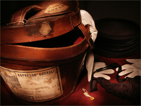 Nostalgic still life of antique hat box + lingerie
