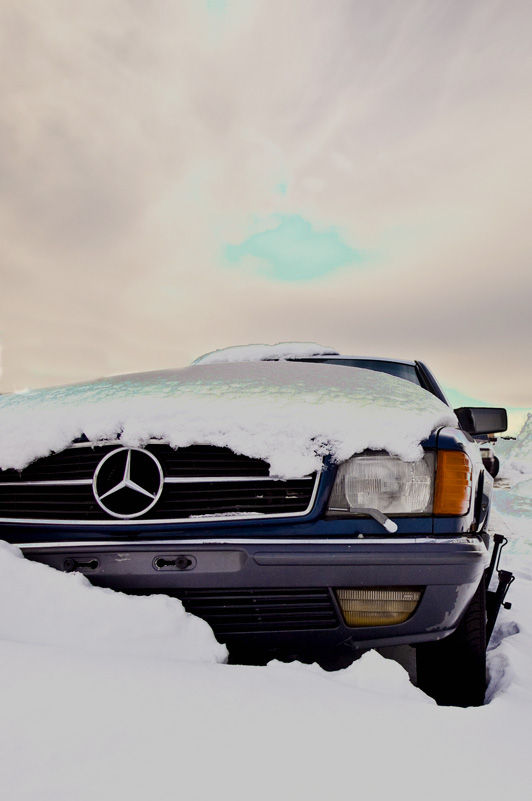 A old mercedes snowed in