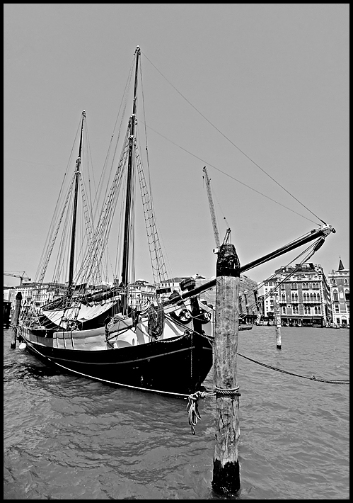 An old sailboat in Venice in black and white