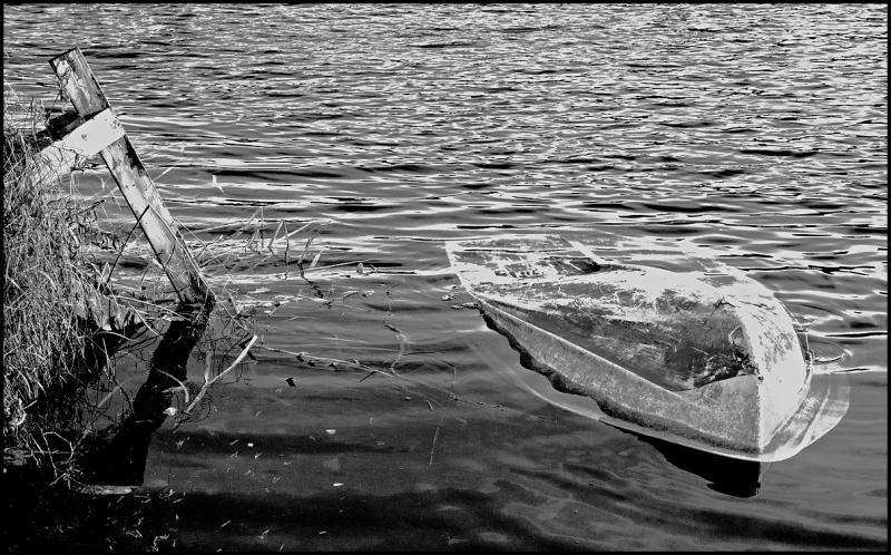 A sunken boat in the water