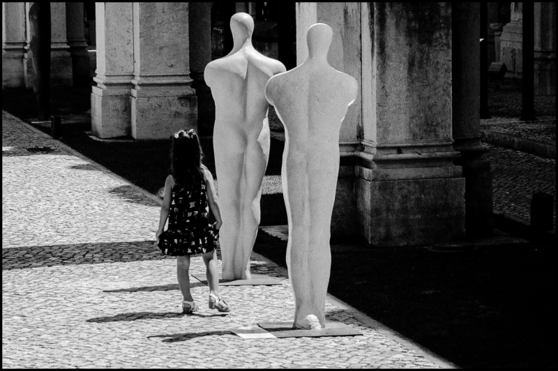 Girl and statues