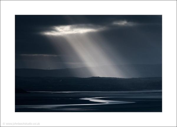shaft of sunlight morecambe bay landscape