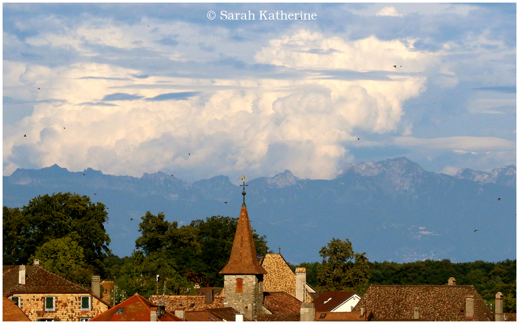 village, clouds, starlings. mountains