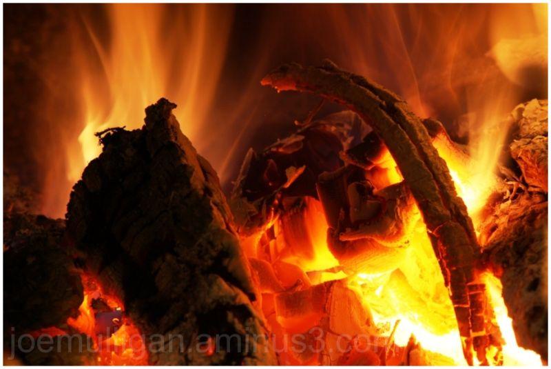 blazing fire in a winter woodstove