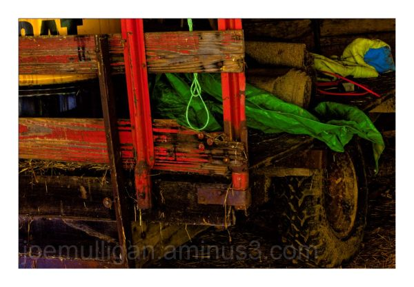 RED WAGON WITH HANGING ROPE