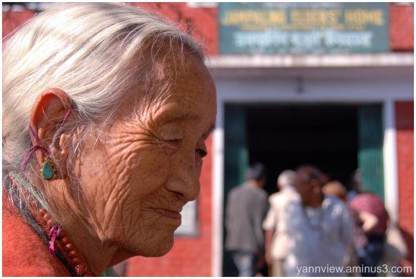 Portrait of an Tibetan woman at old folk home
