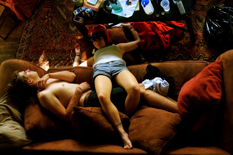 Two people lying on couch