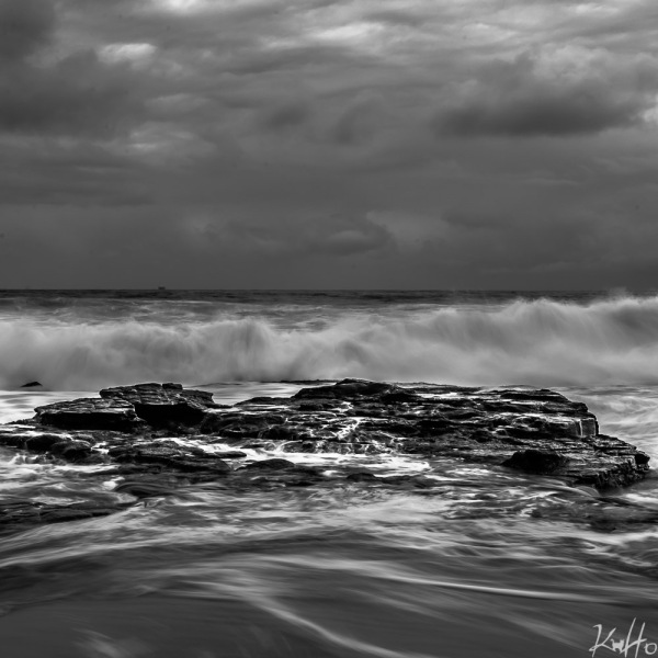 rocks and waves at a beach