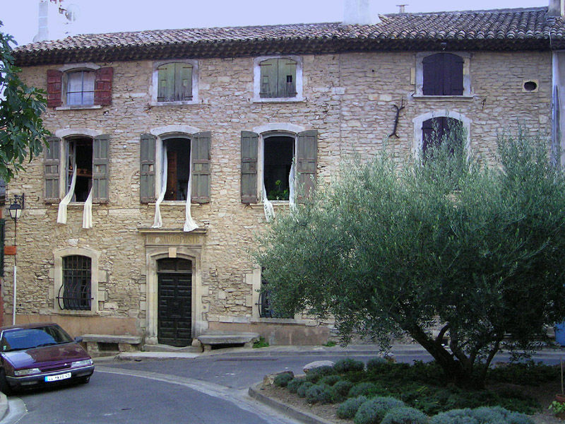 A stone-sided house in a village in Provence.