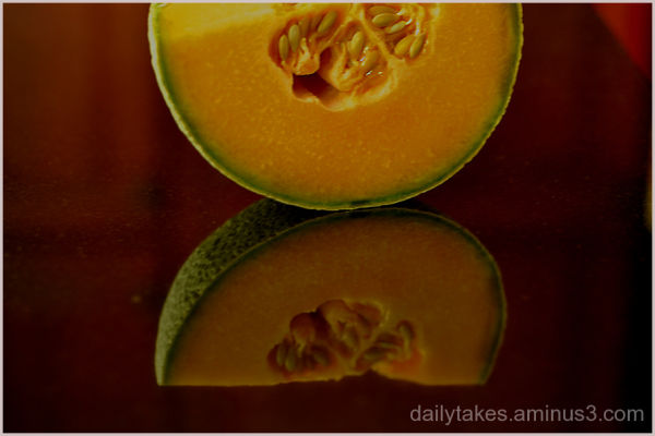 cantaloupe reflected on countertop.....