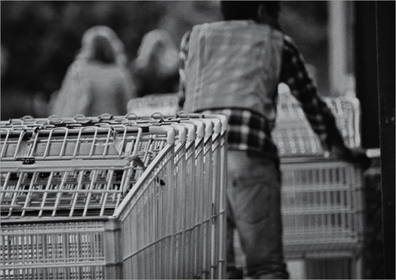 men at work: gathering shopping carts