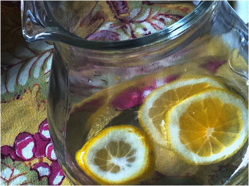 water pitcher with lemon slices  . . .