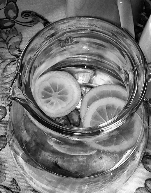 water pitcher with sliced lemons  . . .