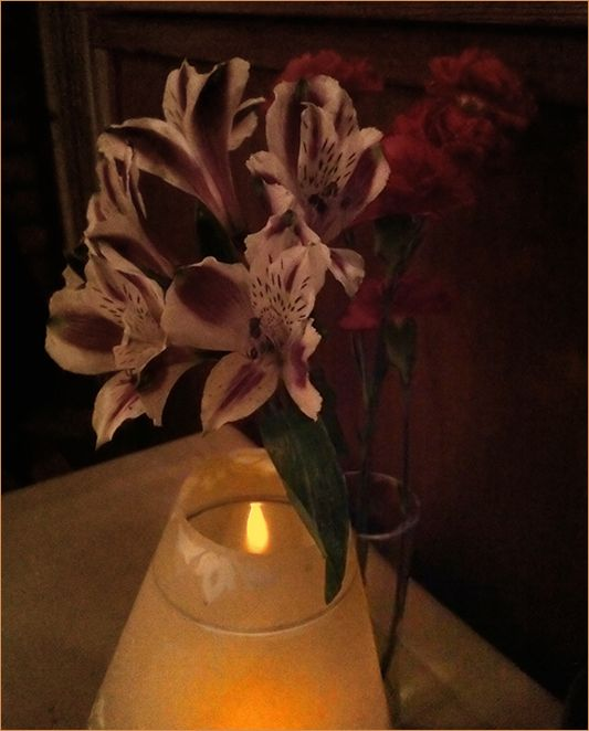 a dinner with candlelight and flowers  . . .