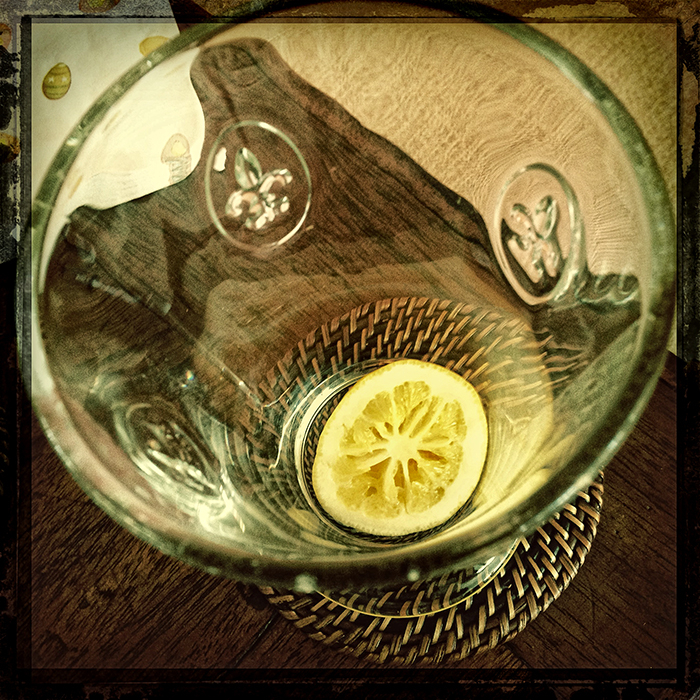 glass with slice of lemon