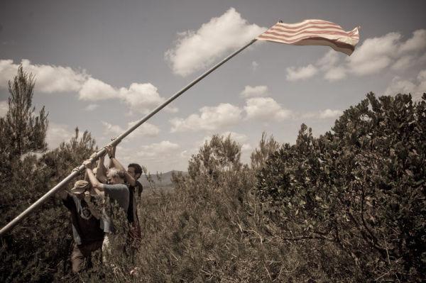 Raising the flag in Sant Miquel