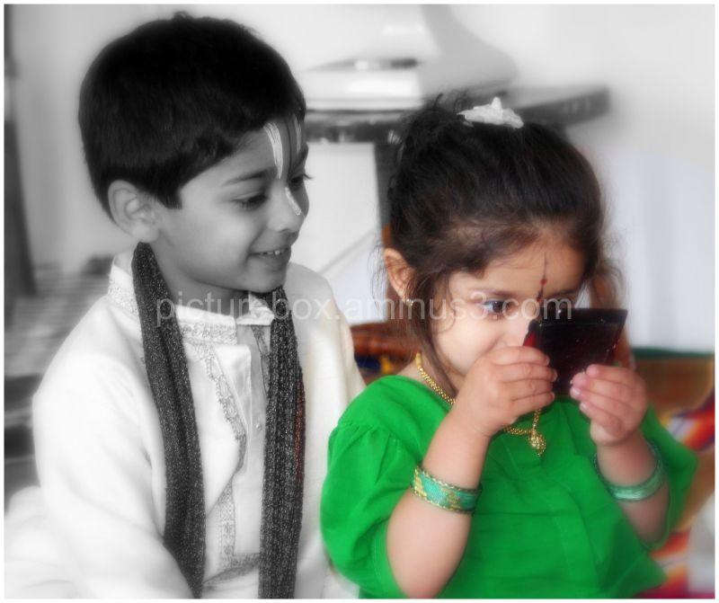 Kids looking at mirror