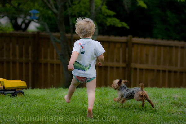 Boy and Dog running.