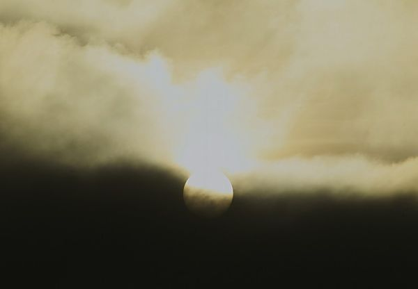 sun in stormclouds