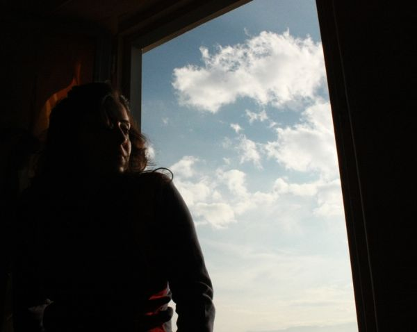 sky, clouds, and the girl sitting in the frame...