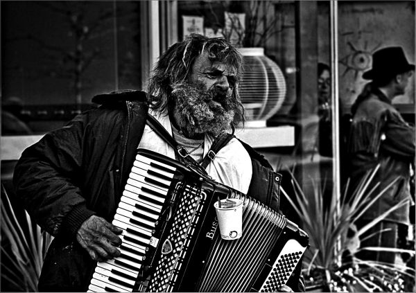 Homeless Man Playing Accordion